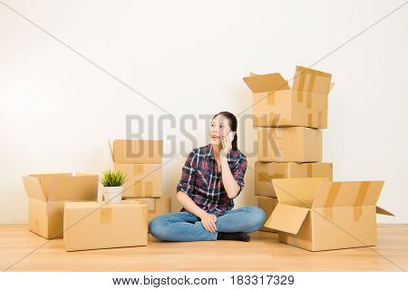 Girl Using Smartphone Sitting On Boxes