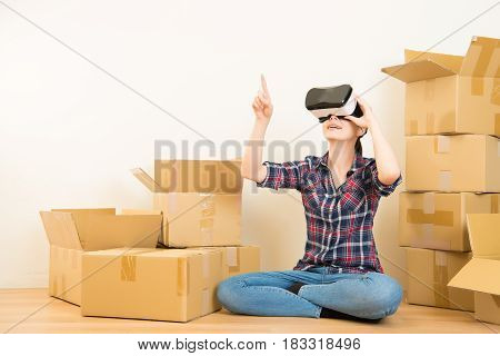 Woman Moving House Working With Vr Headset