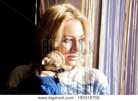 Young woman with pet dog