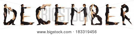 Black dressed people forming word DECEMBER on white background