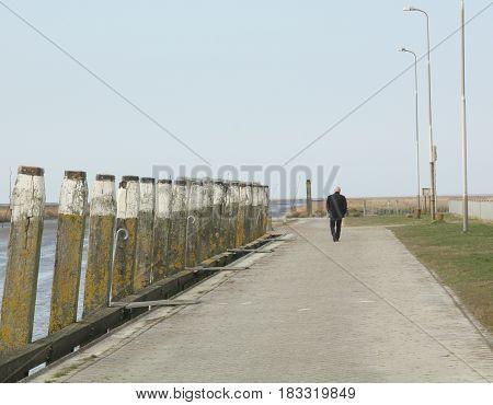 Tourist walking on the pier of Noordpolderzijl. The Netherlands