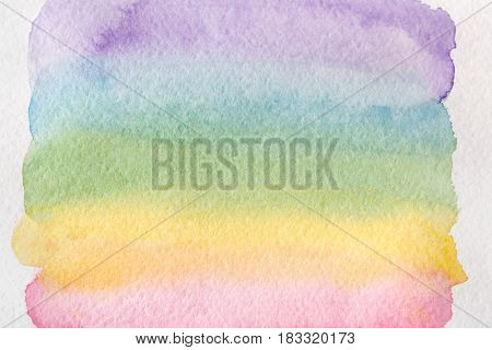 Pastel watercolor rainbow. Creative abstract hand painted background, wallpaper, texture, blue and violet colored painting