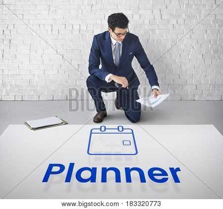 Man planning with illustration of personal organizer calendar