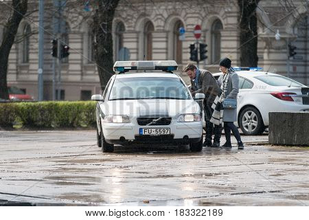 RIGA LATVIA - APRIL 22 2017: Tweed ride 2017. To ensure safety the measures staying multiple police crews.