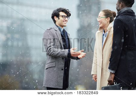 Businessman meeting his partners in snowfall
