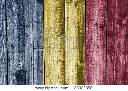 Colorful and crisp image of flag of Chad on weathered wood