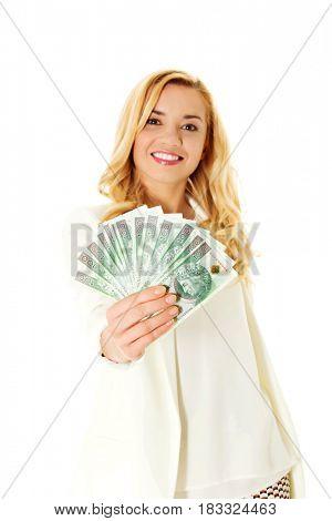 Beautiful casual woman holding money.