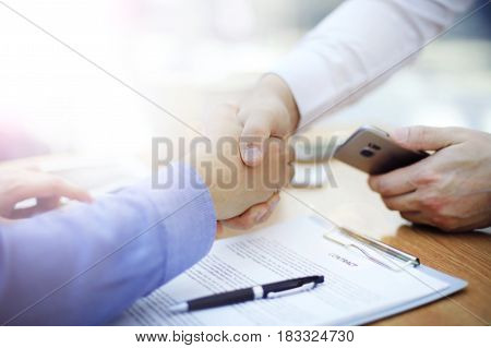 business man handshake in modern office after good deal