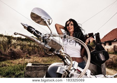 Beautiful Motorcycle Brunette Woman With A Classic Motorcycle (cinema Bleach Bypass Effect)