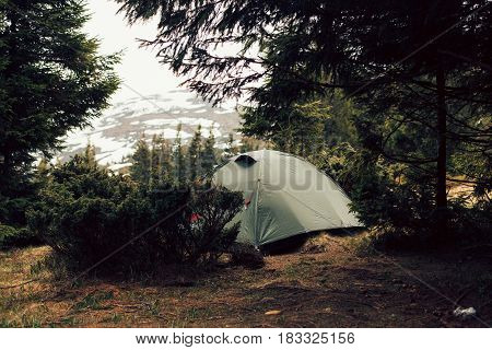 Camping tent in the forrest and mountains