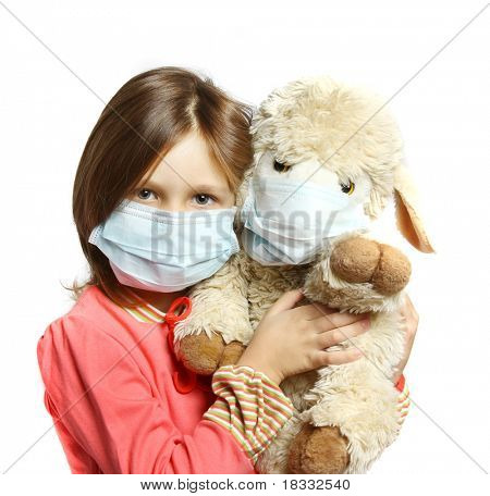 Little girl with toy wearing a protective mask
