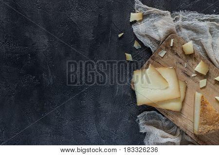 Italian Hard Cheese Pecorino Toscano Sliced And Chopped On Wooden Board On Dark Rustic Background, T