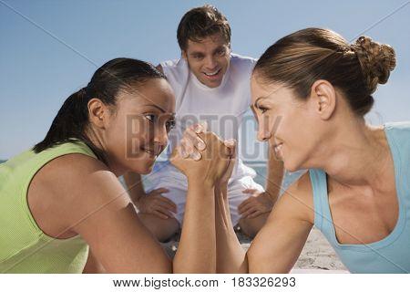 Hispanic women arm wrestling