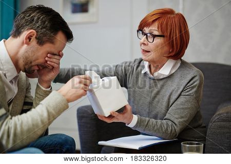 Depressed man visiting his psychologist