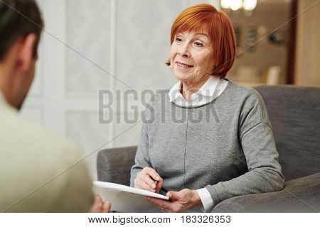 Senior psychiatrist talking to one of her patients