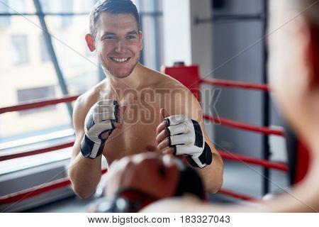 Smiling Man Enjoying Boxing Practice