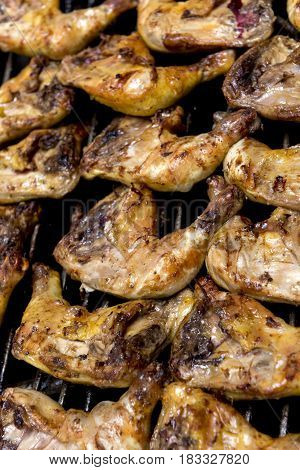 Broiled Chicken Quarters On A Barbecue Grill