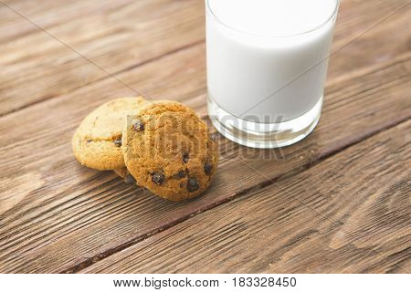 Chocolate Chip Cookies With Milk On Rustic Wooden Table
