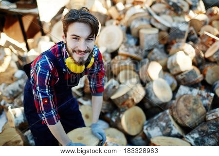Young man working on lumberyard