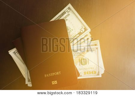 Passport and Dollar Money travel plan concept.