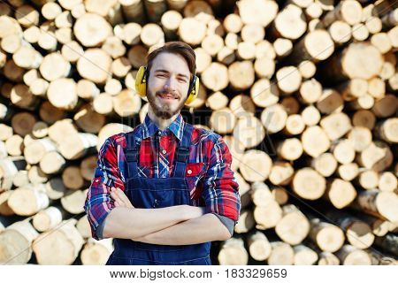 Tree service worker in protective headphones