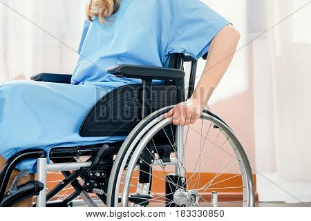Partial View Of Wheelchair Woman In Hospital Chamber