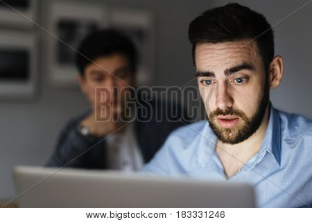 Young businessman looking at interesting information in the net