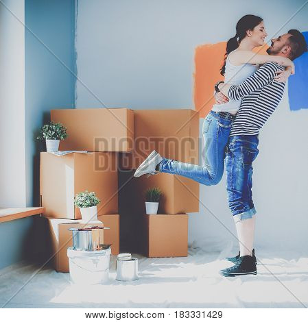 Happy young couple moving in new house.