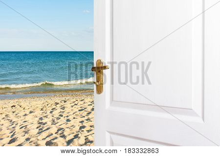 White doors Open to the beach. Entrance exit to the room house to the sea. The concept of relaxation vacation a new life