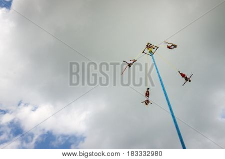 El Tajin Mexico - May 21 2014: Man performing the Dance of the Flyers (Danza de Los Voladores) in the El Tajin Mexico.