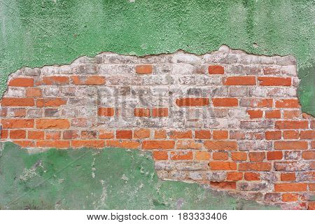 Background Of  Orange Brick Wall, Masonry In A Row And Old, Green, Cracked Plaste