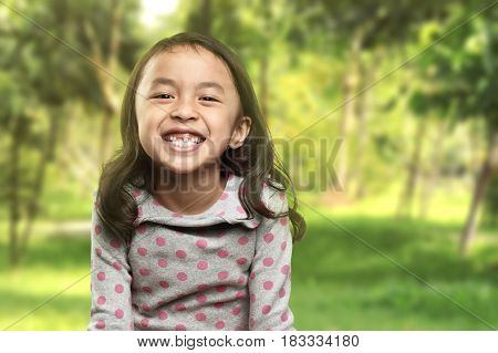 Funny Asian Little Girl Smile With Her Broken Tooth