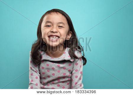 Smiling Asian Little Girl And Her Broken Teeth