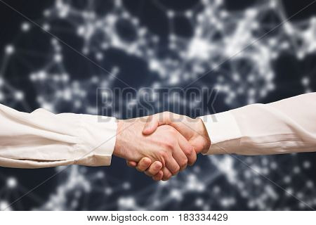 Handshake Of Two Businessmen On An Abstract Background Of Technology