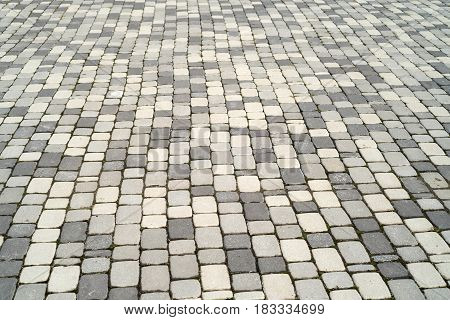 Perspective view of texture of road surface made of grey and white pave stones