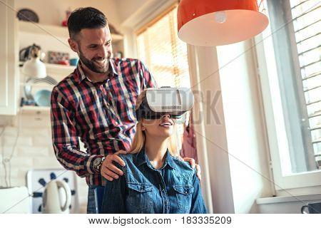 Woman using virtual reality headset at home.