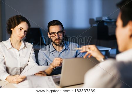 Group of architects organizing their work or discussing ideas
