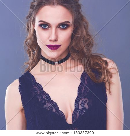 Close up portrait of beautiful young woman face. Isolated on gray background.