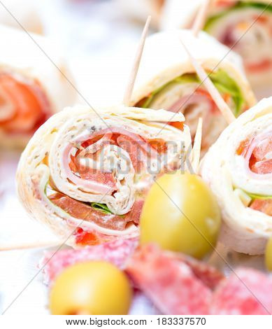 mix appetizers at wedding table. close details