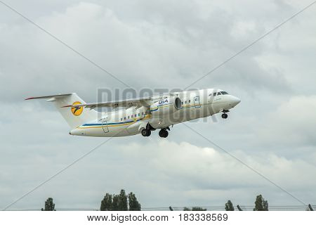 Borispol Ukraine - October 2 2011: Antonov An-148 regional passenger plane is taking off from the airport into cloudy autumn sky