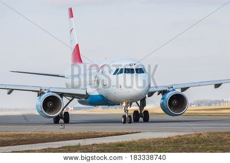 Borispol Ukraine - October 23 2011: Austrian Airlines Airbus A319-112 taxiing in the airport for takeoff on a cloudy day