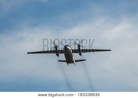Kiev Region Ukraine - January 5 2012: Iraqi Air Force An-32 cargo plane in flight with blue sky on the background