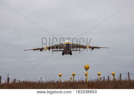 Kiev Region Ukraine - January 8 2012: Antonov An-225 Mriya cargo plane is on finallanding at dusk in the airport