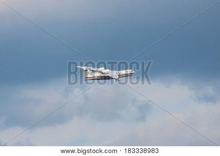 Gelendzhik Russia - September 8 2010: Beriev Be-200 plane in flight against blue sky on the background