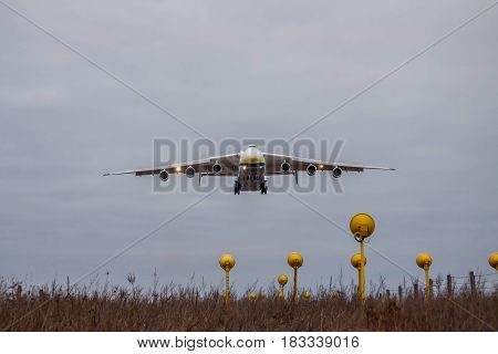 Kiev Region Ukraine - January 8 2012: Antonov An-225 Mriya cargo plane is on finallanding at dusk