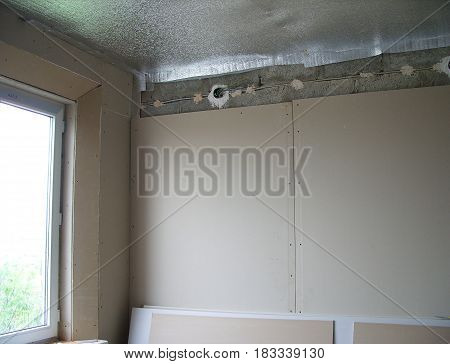 Decorating a room with insulation and sheets of drywall