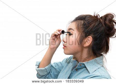 Beautiful asian woman applying mascara on her eyelashes white background