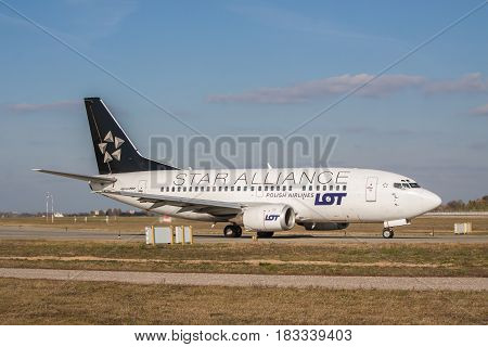 Borispol Ukraine - October 23 2011: LOT Airlines Boeing 737 passenger plane is Star Alliance livery tsxiing to the runway for takeoff