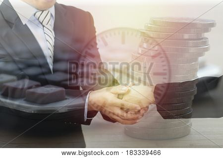 double exposure businessman shaking hand and object buisiness concept in corporate and communicate to success