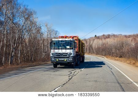 PRIMORYE RUSSIA - APRIL 7 2017: Timber carrier Mercedes Actros on a road